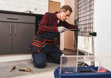 new refrigerator installation senior male technic